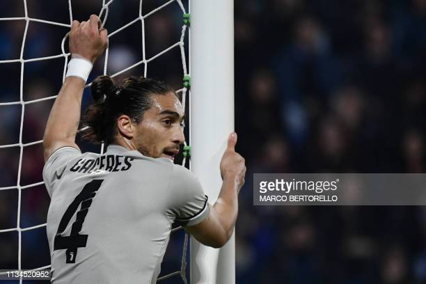 Juventus' Uruguayan defender Martin Caceres holds the post after missing a goal during the Italian Serie A football march Cagliari vs Juventus on...