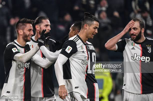 Juventus' Uruguayan midfielder Rodrigo Bentancur celebrates with Juventus' French midfielder Adrien Rabiot Juventus' Brazilian defender Alex Sandro...