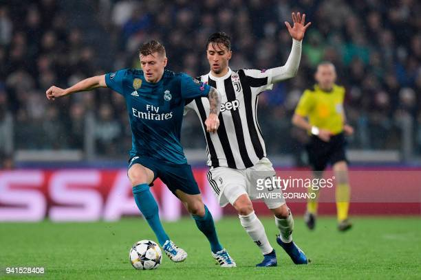Juventus' Uruguayan midfielder Rodrigo Bentancur challenges Real Madrid's German midfielder Toni Kroos during the UEFA Champions League quarterfinal...