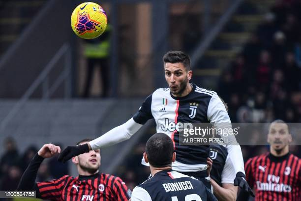 Juventus' Uruguayan midfielder Rodrigo Bentancur goes for a header during the Italian Cup semi-final first leg football match AC Milan vs Juventus...