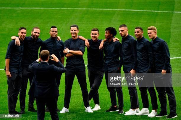 Juventus' Uruguayan midfielder Rodrigo Bentancur Juventus' Argentinian forward Gonzalo Higuain Juventus' Brazilian defender Alex Sandro Juventus'...