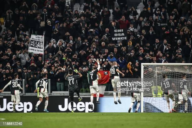Juventus' Uruguayan midfielder Rodrigo Bentancur Juventus' Brazilian defender Danilo Juventus' Italian goalkeeper Gianluigi Buffon Juventus'...