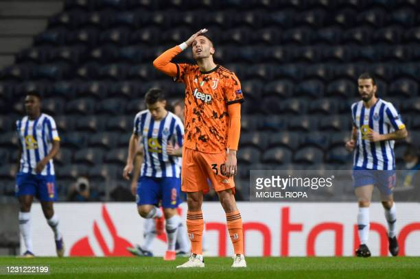 Juventus' Uruguayan midfielder Rodrigo Bentancur reacts to Porto's opening goal scored by FC Porto's Iranian forward Mehdi Taremi during the UEFA...