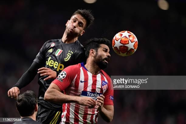 Juventus' Uruguayan midfielder Rodrigo Bentancur vies with Atletico Madrid's Spanish forward Diego Costa during the UEFA Champions League round of 16...
