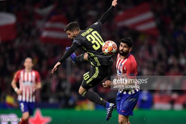TOPSHOT Juventus' Uruguayan midfielder Rodrigo Bentancur vies with Atletico Madrid's Spanish forward Diego Costa during the UEFA Champions League...