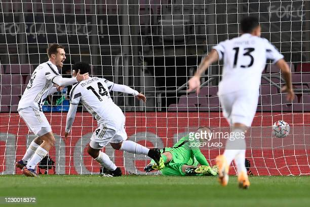 Juventus' US midfielder Weston McKennie celebrates with teammates after scoring a goal during the UEFA Champions League group G football match...