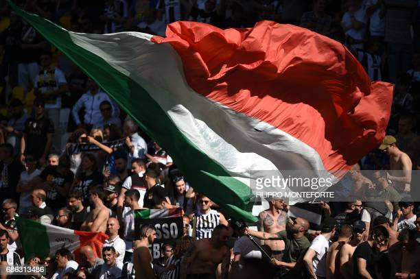 Juventus' wave a giant flags after winning the Italian Serie A football match Juventus vs Crotone and the 'Scudetto' at the Juventus Stadium in Turin...
