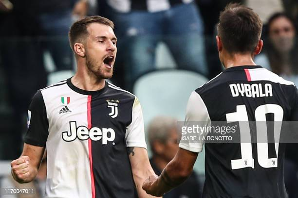 Juventus' Welsh midfielder Aaron Ramsey celebrates after scoring an equalizer during the Italian Serie A football match Juventus vs Verona on...