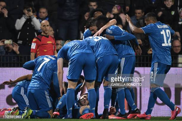 Juventus' Welsh midfielder Aaron Ramsey celebrates with his teammates after scoring his team's second goal during the Italian Serie A football match...