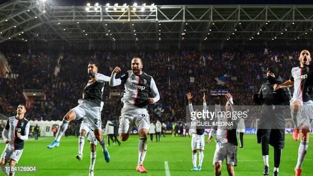 Juventus' Welsh midfielder Aaron Ramsey, Juventus' German midfielder Emre Can, Juventus' Argentinian forward Gonzalo Higuain, Juventus' Argentine...