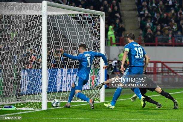 Juventus' Welsh midfielder Aaron Ramsey scores during the UEFA Champions League group D football match between FC Lokomotiv Moscow and Juventus at...