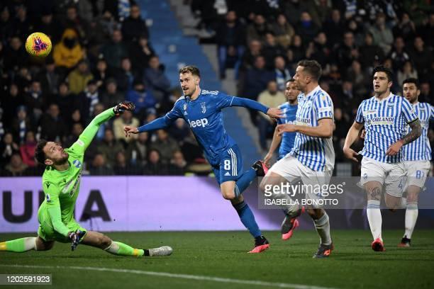 Juventus' Welsh midfielder Aaron Ramsey scores his team's second goal past Spal's Albanian goalkeeper Etrit Berisha during the Italian Serie A...