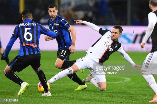 Juventus' Welsh midfielder Aaron Ramsey tackles Atalanta's Argentinian defender Jose Luis Palomino during the Italian Serie A football match Atalanta...