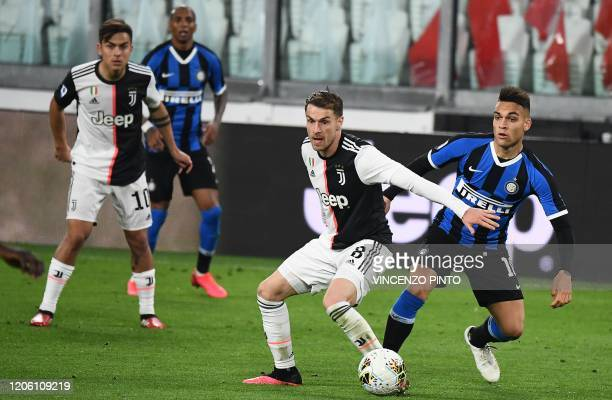 Juventus' Welsh midfielder Aaron Ramsey vies with Inter Milan's Argentinian forward Lautaro Martinez during the Italian Serie A football match...