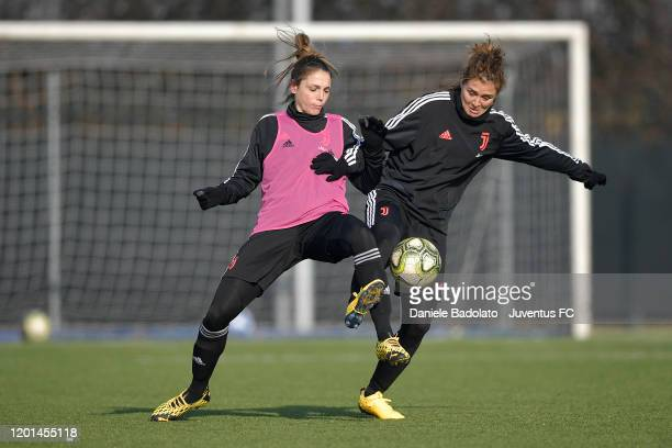 Juventus women players Cecilia Salvai competes for the ball with Cristiana Girelli during a training session at Juventus Center Vinovo on January 23,...