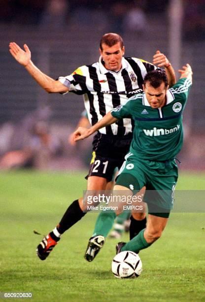 Juventus' Zinedine Zidane tries to avoid fouling Panathinaikos' Ioannis Goumas