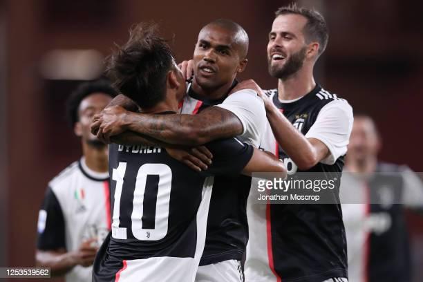 Juventus's Brazilian striker Douglas Costa celebrates with Bosnian midfielder Miralem Pjanic and Argentinian striker Paulo Dybala after scoring to...