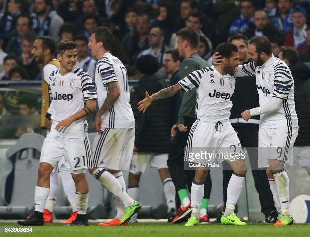 Juventus's defender Dani Alves celebrates with teammate Juventus's forward Gonzalo Higuain after scoring a goal in action during the UEFA Champions...