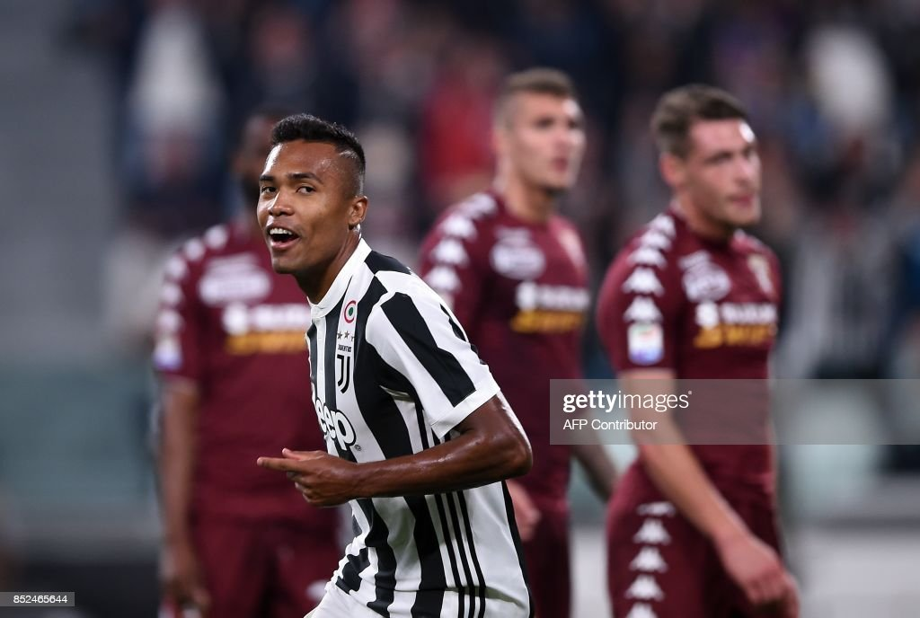 Juventus's defender from Brazil Alex Sandro celebrates after scoring during the Italian Serie A football match Juventus vs Torino at the Allianz Stadium in Turin on September 23, 2017. /
