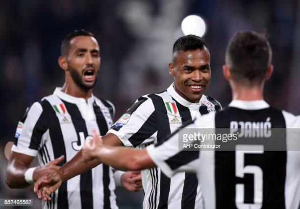 Juventus's defender from Brazil Alex Sandro celebrates with teamates after scoring during the Italian Serie A football match Juventus vs Torino at...