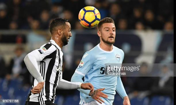 Juventus's defender from France Medhi Benatia fights for the ball with Lazio's midfielder from Serbia Sergej MilinkovicSavic during the Italian Serie...