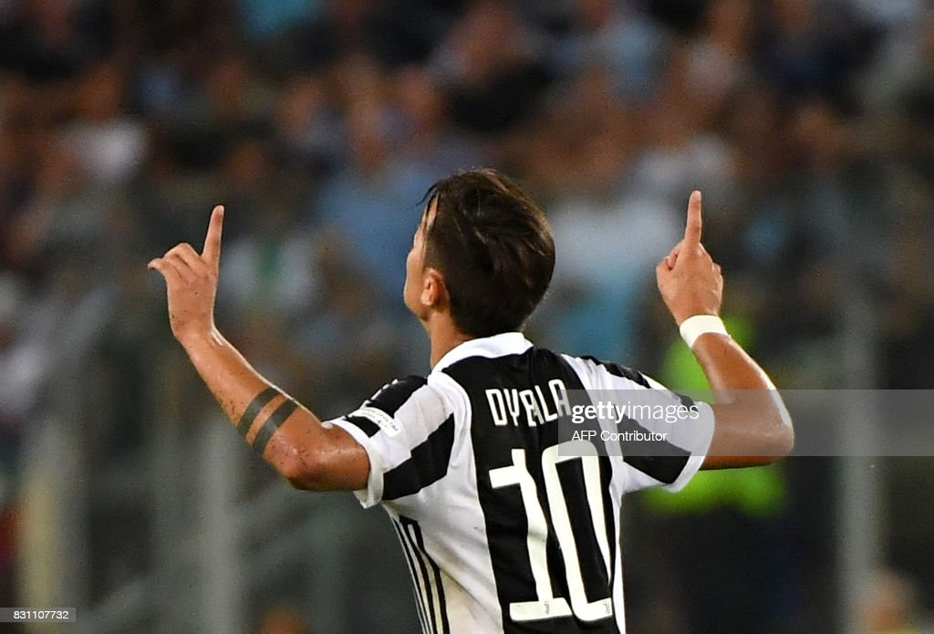 Juventus's forward from Argentina Paulo Dybala celebrates after scoring during the Italian SuperCup TIM football match Juventus vs lazio on August 13, 2017 at the Olympic stadium in Rome. /