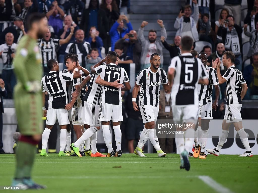 Juventus's forward from Argentina Paulo Dybala (2ndL Rear) celebrates with teammates after scoring during the italian Serie A football match Juventus vs Torino at the Allianz Stadium in Turin on September 23, 2017. /
