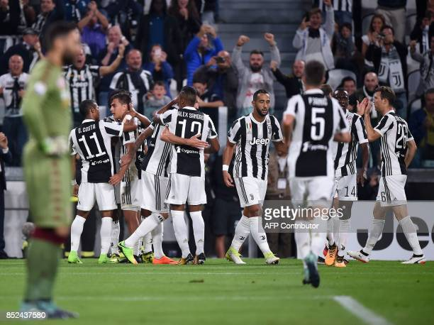 Juventus's forward from Argentina Paulo Dybala celebrates with teammates after scoring during the italian Serie A football match Juventus vs Torino...