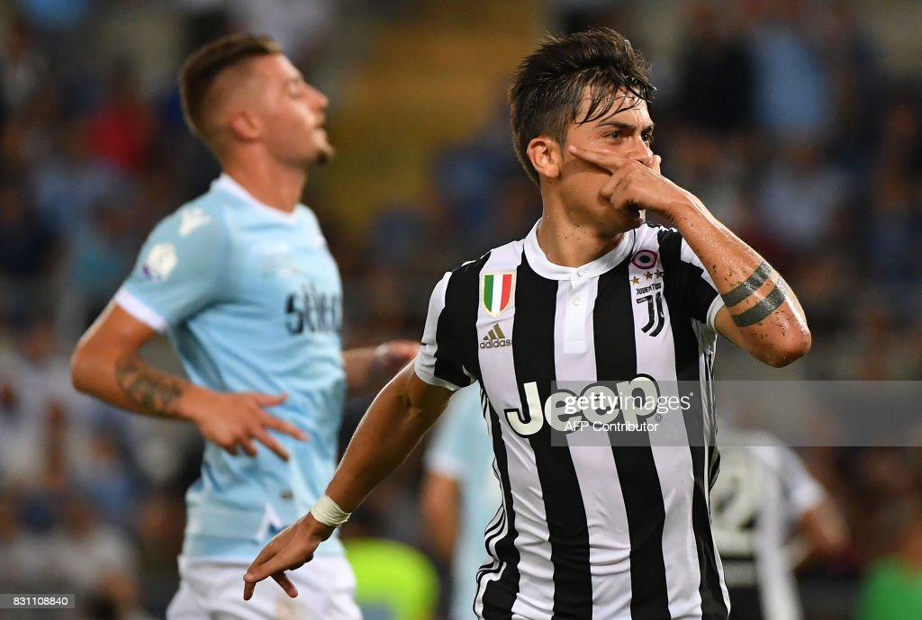 Juventus's forward from Argentina Paulo Dybala celebrtaes after scoring a penalty during the Italian SuperCup TIM football match Juventus vs lazio on August 13, 2017 at the Olympic stadium in Rome. /