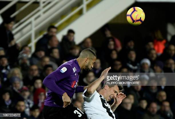 Juventus's forward Mario Mandzukic from Croatia vies for the ball against Fiorentina defender Victor Hugo of Brazil during their Serie A football...