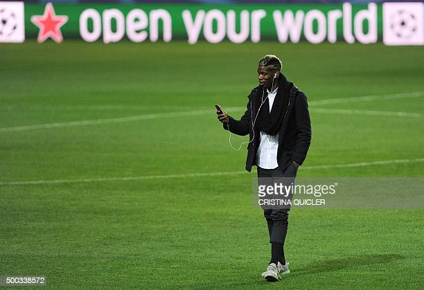 Juventus's French midfielder Paul Pogba looks at his phone at the Ramon Sanchez Pizjuan stadium in Sevilla on December 7 on the eve of the UEFA...