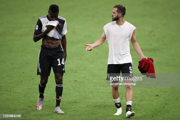 Juventus's midfielder Blaise Matuidi and midfielder Miralem Pjanic leave the field of play following the final whistle of during the Serie A match...