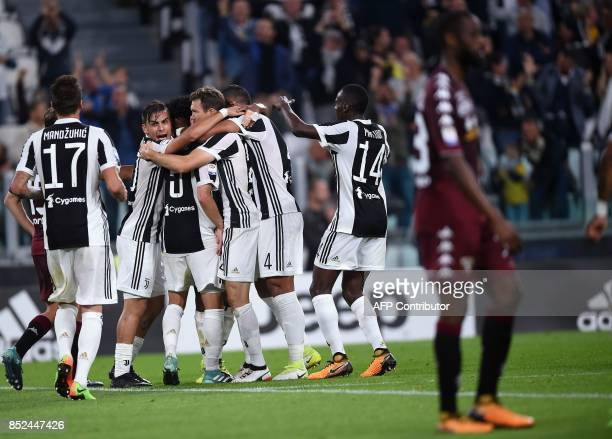 Juventus's midfielder from BosniaHerzegovina Miralem Pjanic is celebrated by teammates after scoring during the italian Serie A football match...