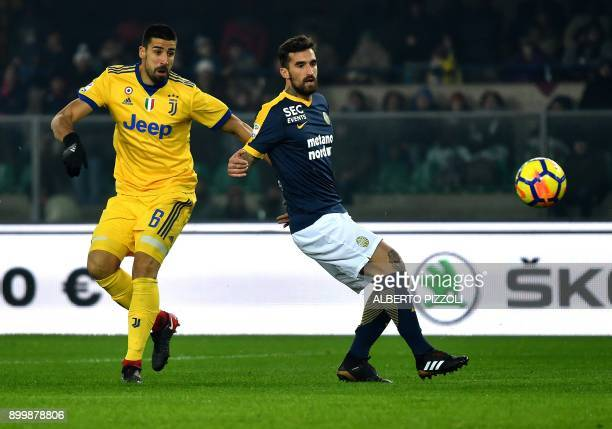 Juventus's midfielder from Germany Sami Khedira fights for the ball with Hellas Verona's Italian defender Antonio Caracciolo during the Italian Serie...