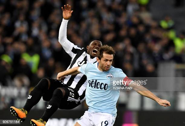 Juventus's midfielder from Ghana Kwadwo Asamoah fights for the ball with Lazio's midfielder from Bosnia Senad Lulic during the Italian Serie A...