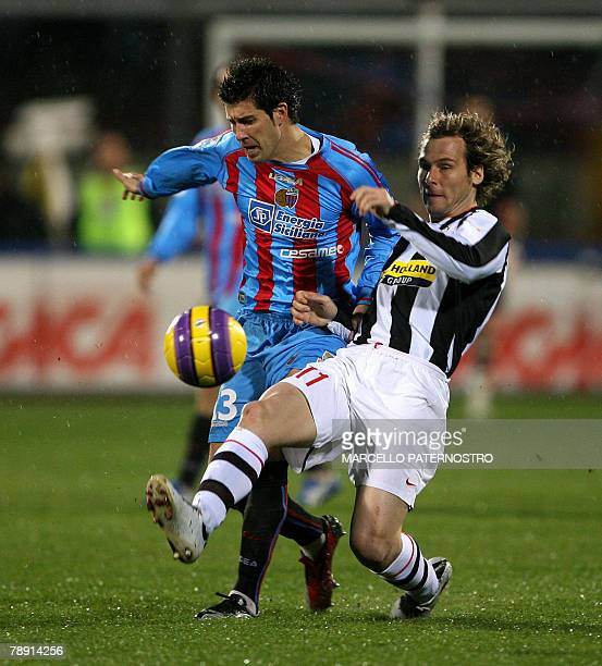 Juventus's midfilder Pavel Nedved of Czech Republic is challenged by Catania's defender Mariano Izco of Argentina during their Serie A football match...