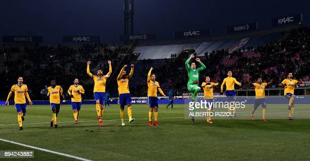Juventus's players celebrate at the end of the Italian Serie A football match Bologna vs Juventus on December 17 2017 at Renato Dall'Ara stadium in...