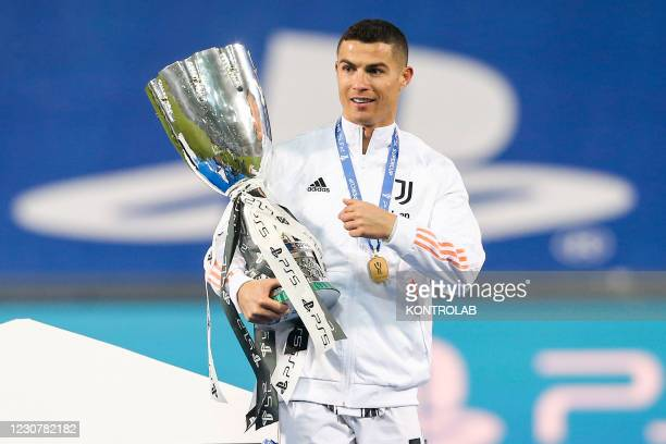 Juventus's Portuguese striker Cristiano Ronaldo holds the trophy during the ceremony oft he Italian PS5 Supercup football match SSC Napoli vs...