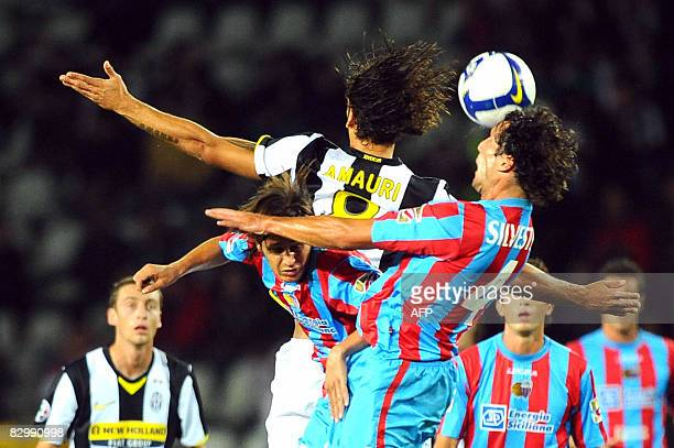 Juventus's striker Amauri vies with Catania's defender Matias Silvestre during their Italian serie A football match at the Olympic Stadium in Turin...