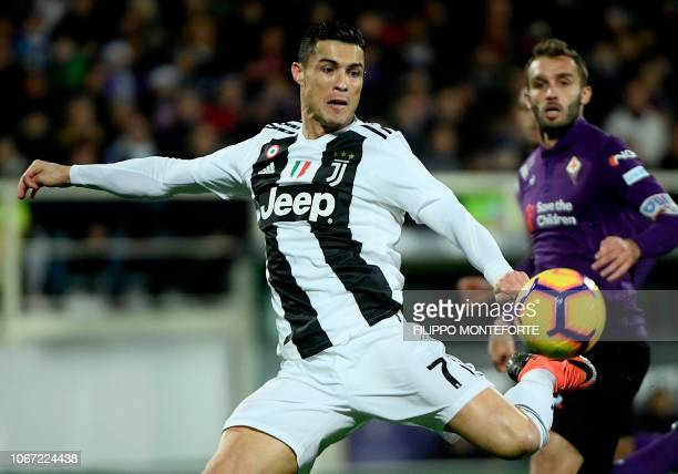 Juventus's striker Cristiano Ronaldo from Portugal eyes the ball during the Serie A football match Fiorentina versus Juventus on December 1 at the...