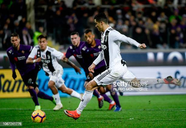 Juventus's striker Cristiano Ronaldo from Portugal kicks a penalty to score during their Serie A football match Fiorentina versus Juventus on...