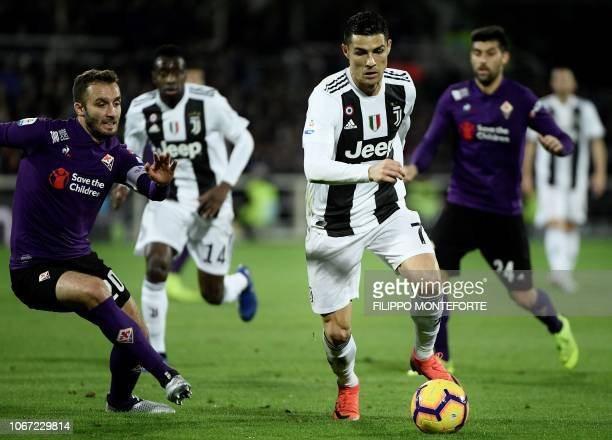 Juventus's striker Cristiano Ronaldo from Portugal vies for the ball against Fiorentina defender Germn Pezzella from Argentina during the Serie A...