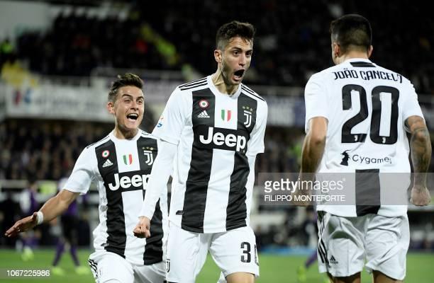 Juventus's Urugayan midfielder Rodrigo Bentancur celebrates with teammates after scoring a goal during the Italian Serie A football match Fiorentina...