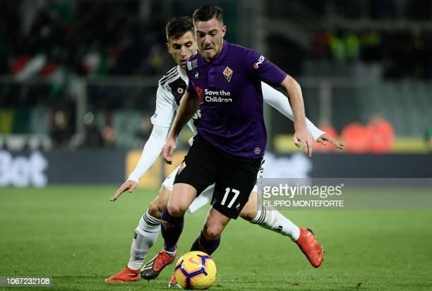 Juventus's Uruguayan midfielder Rodrigo Bentancur vies for the ball with Fiorentina French midfielder Jordan Veretout during the Italian Serie A...