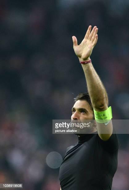 Juve's goalkeeper Gianluigi Buffon after the 42 defeat at the Champions League Last Sixteen Knockout Round Second Leg soccer match between Bayern...