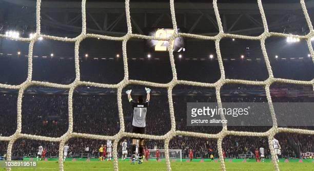 Juve's goalkeeper Gianluigi Buffon celebrates the 22 equalizer during the UEFA Champions League round of 16 first leg soccer match between Juventus...