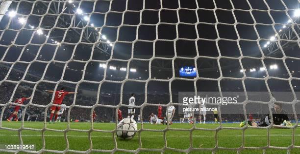 Juve's goalkeeper Gianluigi Buffon eyes the ball after Munich's Lewandowski scored the 02 during the UEFA Champions League round of 16 first leg...