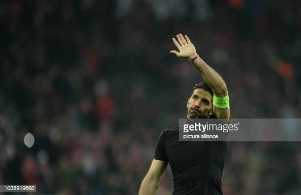 Juve's goalkeeper Gianluigi Buffon thanking his fans after the Champions League Last Sixteen Knockout Round Second Leg soccer match between Bayern...