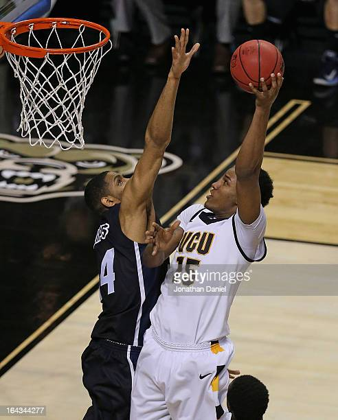 Juvonte Reddic shoots over Zeke Marsahll of the VCU Rams of the Akron Zips during the second round of the 2013 NCAA Men's Basketball Tournament at...