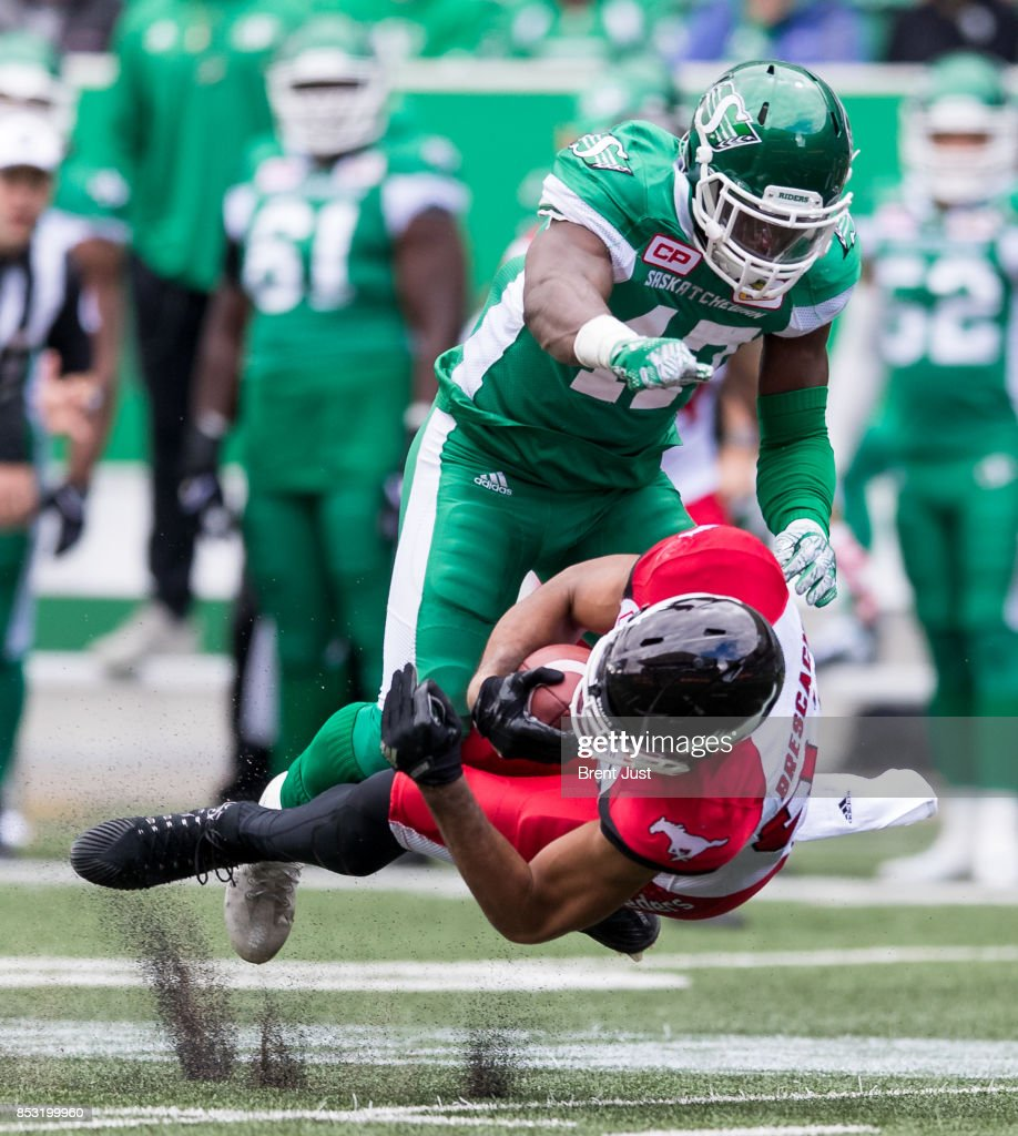 Juwan Brescacin #82 of the Calgary Stampeders is levelled by Samuel Eguavoen #47 of the Saskatchewan Roughriders in first half action of the game between the Calgary Stampeders and Saskatchewan Roughriders at Mosaic Stadium on September 24, 2017 in Regina, Canada.